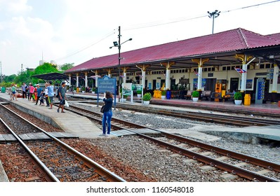 Ayutthaya, Thailand - April 14, 2017: Locals and tourists waiting for the commuter train at Ayutthaya Station.