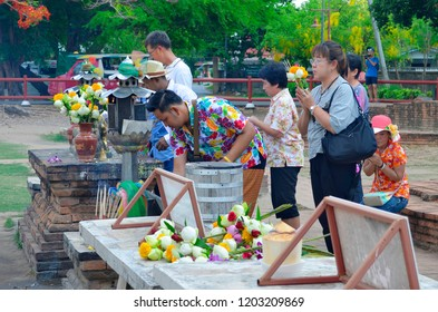 Ayutthaya, Thailand - April 14, 2017: Worshippers at Wat Lokayasutharam.
