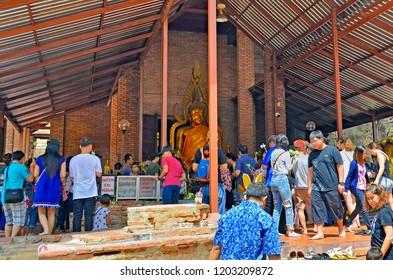 Ayutthaya, Thailand - April 14, 2017: Worshippers at Wat Yai Chai Mongkhon.