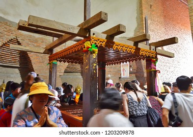 Ayutthaya, Thailand - April 14, 2017: Worshippers inside the chedi at Wat Yai Chai Mongkhon.