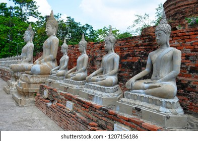 Ayutthaya, Thailand - April 14, 2017: Row of Buddha statues at Wat Yai Chai Mongkhon.