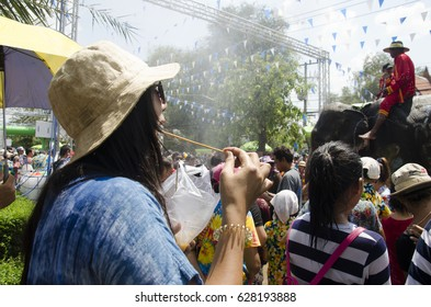 AYUTTHAYA, THAILAND - APRIL 14 : Thai people and foreigner travelers playing and splashing water with women eating food in Songkran Festival at Ayutthaya city on April 14, 2017 in Ayutthaya, Thailand
