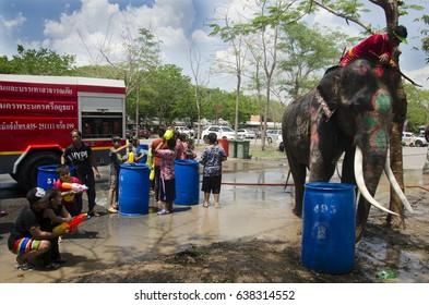AYUTTHAYA, THAILAND - APRIL 14 : Thai people and foreigner travelers playing and splashing water with elephants and people in Songkran Festival at Ayutthaya on April 14, 2017 in Ayutthaya, Thailand