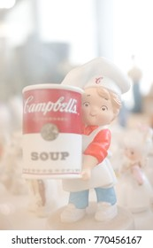Ayutthaya, Thailand - Dec 2017, 3 : Soft focus of a chef boy holding a can of Campbells soup. Campbell's products, belong to an American brand, are sold in 120 countries worldwide. soft dreamy effect