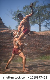 AYUTTHAYA, THAILAND - DECEMBER 17: Two ancient fighter  that known as Muay Thai are fighting in the archaeological site on December 17, 2017 in Ayutthaya.