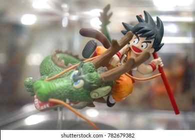 Ayutthaya, Thailand - December 3, 2017: A photo of Son Gohan (kid) is riding on a dragon is displayed on shelf. Gohan is a protagonist from Dragon Ball Z, Japanese famous animation and manga.