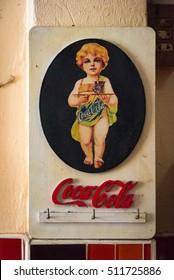 Ayutthaya, Thailand - December 30, 2015: Vintage Coca Cola advertisement poster design with child serving Coca Cola in glass