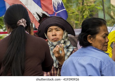 Ayutthaya, Thailand - Feb 20, 2014: The lady - Thai rice farmer during the convoy march on Asia road (AH1) to demand for unpaid subsidy for pledged rice
