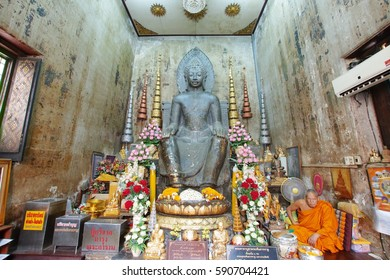 AYUTTHAYA, THAILAND - FEB 24, 2017: Phra Khantharat was carved in green stone in Gupta style it's 1 of 5 seated Buddha images in Thailand which is worth preserved at WatNa Phramen, Ayutthaya, Thailand