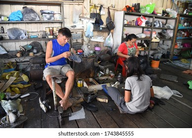 AYUTTHAYA, THAILAND- JANUARY 28, 2019: shoemaker at work in the city on January 28 2019 in Ayutthaya, Thailand