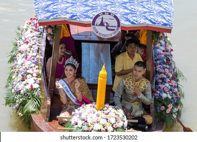 AYUTTHAYA, THAILAND - July 16, 2019 : Traditional parading of candles to temple by the river ceremony on The Buddhist Lent Day (Aquatic Phansa at Ladchado Canal).