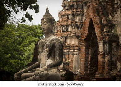 AYUTTHAYA (THAILAND) - JULY 2017: Ruins of Wat Phra Mahathat.  It was a royal monastery that served as the seat of the Sangaraja –the head of the Buddhist monks of the Kamayasi Sect.