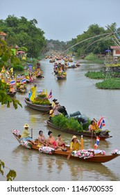 AYUTTHAYA, THAILAND - July 27, 2018 : Buddhists do candle festival parade by boat at Ladchado canal in Ayuthaya.