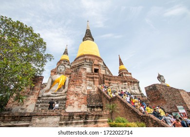Ayutthaya, Thailand - July 28, 2018: Tourists visiting the ruins of the old city of Ayutthaya in Wat Yai Chai Mongkhon, Ayutthaya Historical Park, Thailand.