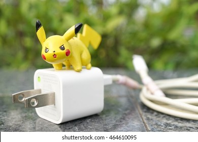 AYUTTHAYA, THAILAND - JULY 30, 2015 : Closed up of Pikachu on top of electronic plug. Pikachu is electronic type pokemon. Concept of Pokemon, a big hit application after its launched in July 2016.