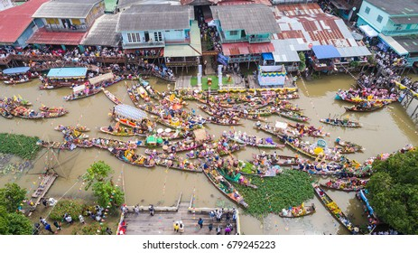 AYUTTHAYA, THAILAND - JULY 8 : Aerial view of festival Buddhist Lent Day merit parade, traditional parade candle to temple by river at Pak Hai Ayutthaya, Thailand on July 8, 2017.