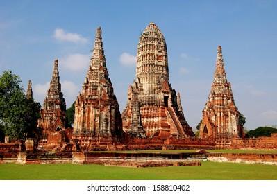 Ayutthaya, Thailand:  The majestic ruins of 1629 Wat Chai Watthanaram built by King Prasat Tong with its principal Prang (center) representing Mount Meru, the abode of the gods *