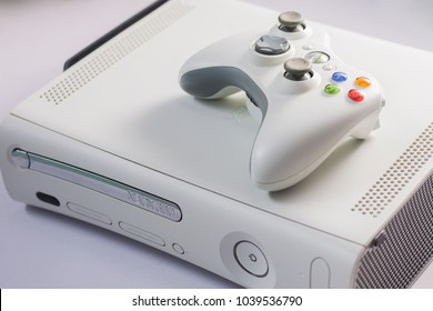 Ayutthaya, Thailand March 6, 2018 : White Xbox 360 live console computer game by Microsoft and joy stick white controller on white background