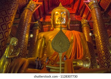 AYUTTHAYA, THAILAND - MAY 16: People work with cloth on Buddha image in Wat Phanan Choeng temple on MAY 16 , 2017 in Ayutthaya, Thailand. Ayutthaya is former capital of Siam former Thailand.
