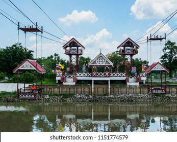 Ayutthaya, Thailand - May 23, 2018: People crossing the canal to visit Wat Niwet Thammaprawat, Thai Buddhist temple. Access to the temple is gained through a cable car strung across the canal.