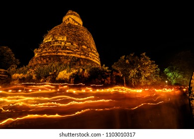 AYUTTHAYA ,THAILAND - May 29, 2018 : Old temple walking with lighted candles in hand around a temple candle light trail of Buddhism Ceremony at temple ruin on Vesak Day thailand