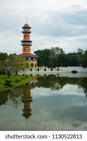 AYUTTHAYA , THAILAND - Nov 24, 2013: Ho Withun Thasana lookout tower and a beautiful garden surrounding it in Bang Pa-In Palace Thailand