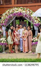 AYUTTHAYA , THAILAND - Nov 24, 2013: Photographing a happy moment of bride and groom family and relatives.Thailand