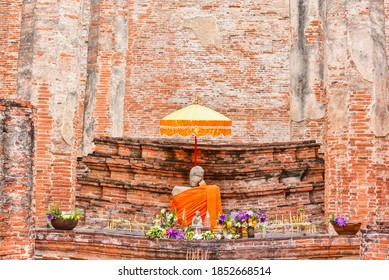 Ayutthaya, Thailand - September 12, 2020: Ancient Stone Buddha Sculpture at Wat Maheyong