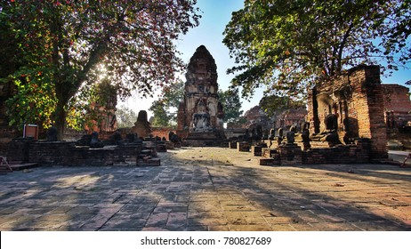 Ayutthaya, Thailand : Wat Mahathat Temple, one of the Unesco World Heritage Site constructed during 14th century. Many tourists visit the temple to see a headless Buddha covered in the tree.