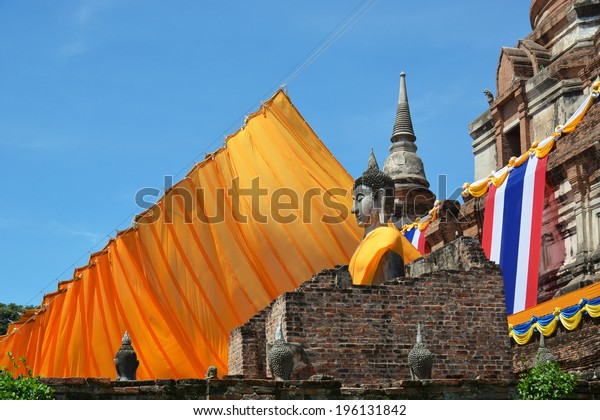 AYUTTHAYA, THAILAND-MAY 13: Wat Yai Chai Mongkol, is situated to the southeast of the city. The large chedi there can be seen from a great distance on May 13, 2014:Visakha  Day in Ayutthaya,Thailand.