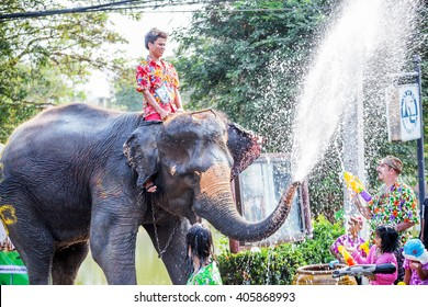 AYUTTHAYA-THAILAND 13 April 2016 - Elephants and people join in water splashing during Thai new year festival or songkran festival in thailand.