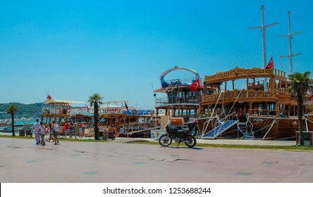 Ayvalik, Balikesir / Turkey - July 11 2015: Touristic tour boats by the sea on Ayvalik