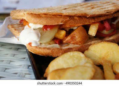 Ayvalik toast, traditional Turkish fast food from aegean town and potato wedges