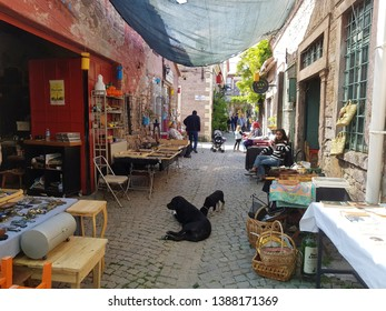 AYVALIK ,TURKEY - APRIL 21, 2018: Colorful historical alive street view with pets in Ayvalik Town.