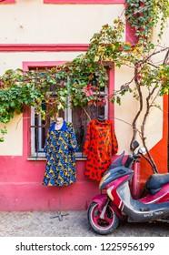 Ayvalik, Turkey - November 08, 2018 : Colorful historical street view in Ayvalik Town.