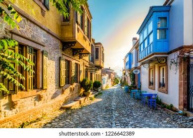 Ayvalik, Turkey - November 08, 2018 : Colorful historical street view in Cunda Island of Ayvalik Town.