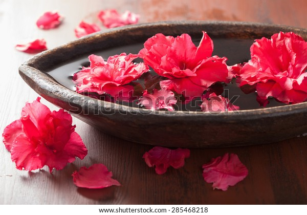 azalea flowers in bowl for aromatherapy spa
