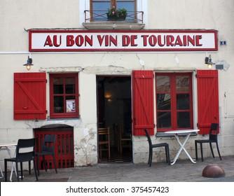 "Azay-le-Rideau, France, 02.11.2016. A fancy restaurant in the Loire valley, near Azay-le-Rideau castle, advertising the ""good wine from Touraine region""."