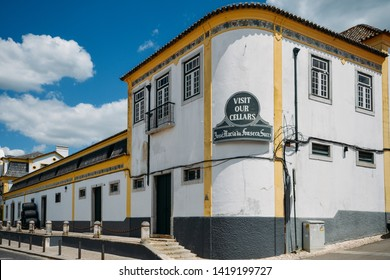 Azeitao, Portugal - June 7, 2019: Sign in English on facade of building of Jose Maria da Fonseca winery in Azeitao, Setubal, Portugal, famous for its Moscatel wine