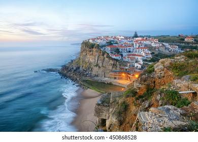 Azenhas do Mar village on a rock facing the atlantic ocean near Lisbon, Portugal at sunset