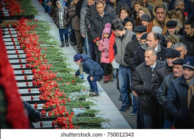 Azerbaijan, Baku, January 20, 2016. People visiting Alley of Martyrs on anniversary of 20th January tragedy when Soviet Army attacked Baku in 1990, killing 137 people, wounding 744