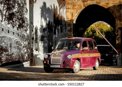 Azerbaijan, Baku - October, 2016: The driver at the wheel of a taxi on the streets of the old town.