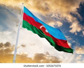 Azerbaijan flag waving against sunset sky