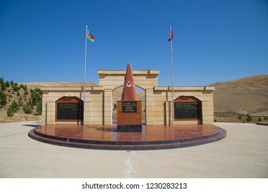 Azerbaijan, Gobustan. Tomb of soldiers of the Caucasian Islamic Army - a monument to Turkish soldiers. Flags of Azerbaijan and Turkey side by side. Gobustan, Azerbaijan - September 21, 2018: