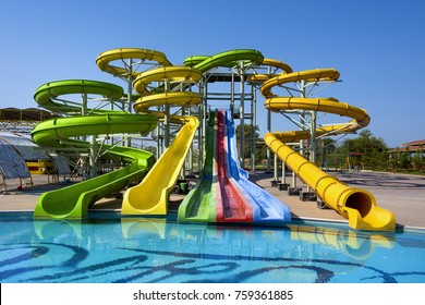 Azerbaijan, near Nabran: Big colorful water slide fun park with swimming pool and blue sky in the background - concept acitivities sports leisure holiday vacation travel fun water. September 15, 2017