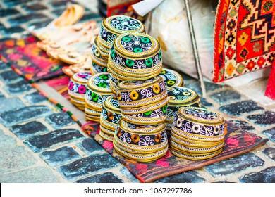 Azerbaijan old style hats on a local market. Oriental headdress on Festive fair on Novruz holiday