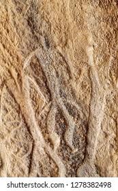 Azerbaijan, Qobustan. Petroglyphs of people carved into a stone at Gobustan National Park.