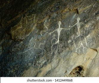 Azerbaijan, Qobustan, Unesco World Heritage Site, Petroglyphs of dancing people and animals.