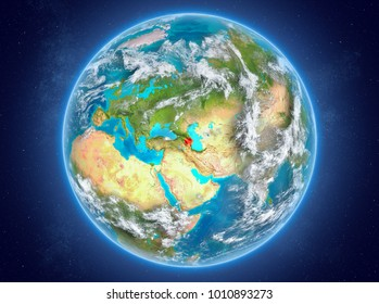 Azerbaijan in red on model of planet Earth with clouds and atmosphere in space. 3D illustration. Elements of this image furnished by NASA.