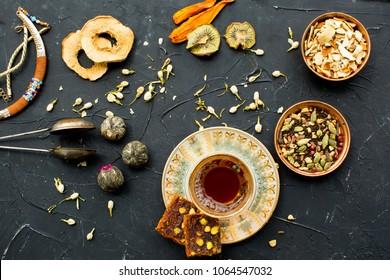 Azerbaijani black tea in armudu tea glass. Atmosphere of Baku and Eastern traditions. Oriental cuisine. Cozy atmosphere in the caucasus cafe.